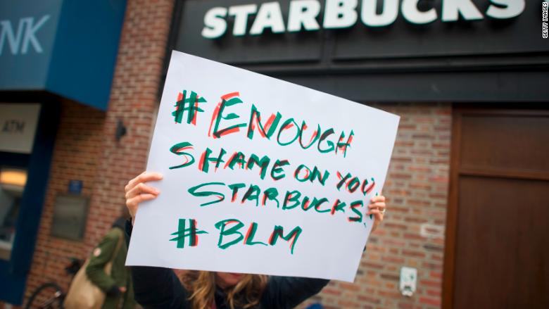 protests sign starbucks
