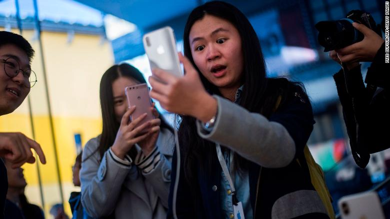 Apple pushes largest screens, cheaper models with new iPhones