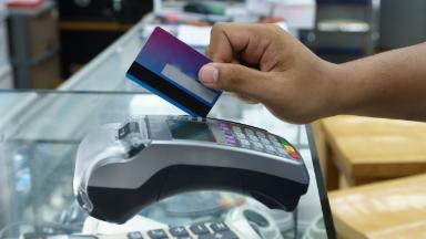 Don't cut up your credit cards yet -- or sell MasterCard, Visa and AmEx