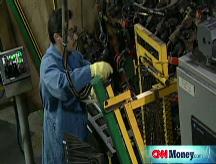 GM, Ford continue cutting