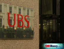 UBS posts $7B loss